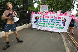 London, UK. 6 July, 2019. Activists from Lesbians and Gays Support The Migrants take part in a London Pride Solidarity March at the very rear of Pride in London - stewards tried to prevent them from joining - in solidarity with those for whom Pride in London is inaccessible and in protest against the corporatisation of Pride in London.