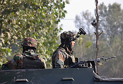 October 9, 2018 - Srinagar, Jammu and Kashmir, India - Indian armymen keep vigil outside the polling station during second phase of Urban Local Bodies (ULB) elections in Sumbal area of north Kashmir some 25 kilometers from Srinagar the summer capital  Indian controlled Kashmir on October 10, 2018.Voting in the second phase of the Local Bodies Elections in Jammu and Kashmir began early morning on Wednesday amid tight security arrangements. (Credit Image: © Faisal KhanZUMA Wire)