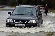 © Licensed to London News Pictures. 11/02/2014. Shepperton and Chertsey, UK Flooding in SHEPPERTON AND CHERTSEY in Surrey today 11th February 2014 after the River Thames burst its banks. The Environment Agency has issued 14 Severe Flood Warnings alone the Thames. Photo credit : Stephen Simpson/LNP