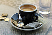 small full espresso coffee cup and small change