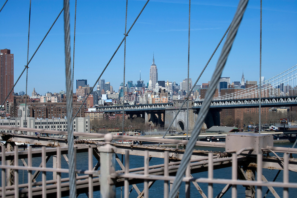 Empire State Building and mid town Manhattan seen from the Brooklyn Bridge New York City