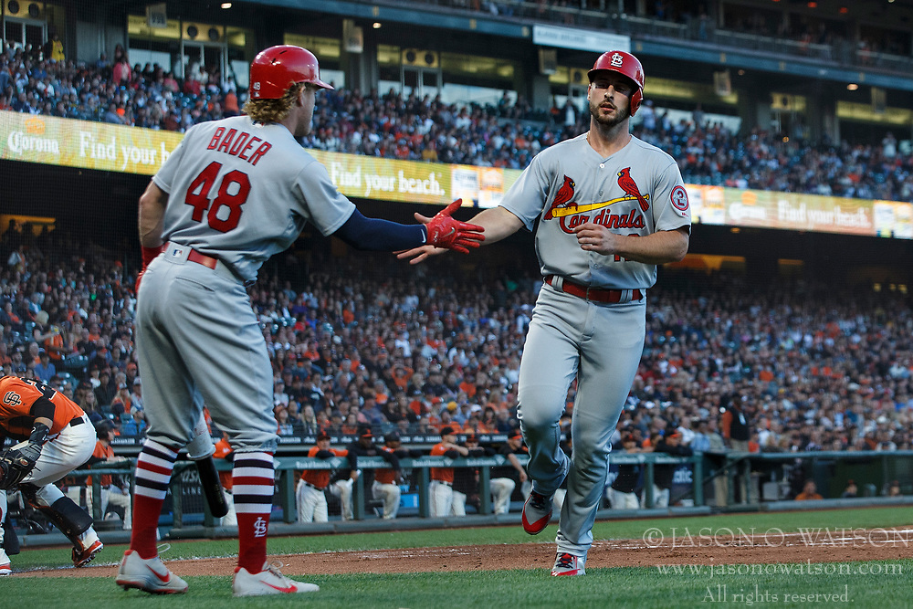 SAN FRANCISCO, CA - JULY 06: Paul DeJong #12 of the St. Louis Cardinals is congratulated by Harrison Bader #48 after scoring a run against the San Francisco Giants during the second inning at AT&T Park on July 6, 2018 in San Francisco, California.  (Photo by Jason O. Watson/Getty Images) *** Local Caption *** Paul DeJong; Harrison Bader
