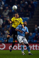 Photo: Jed Wee.<br /> Manchester City v Aston Villa. The FA Cup. 14/03/2006.<br /> <br /> Aston Villa's Wilfred Bouma (L) climbs above Manchester City's Trevor Sinclair to win the ball.