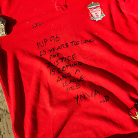 Anfield, Liverpool, UK. 15th April, 2014. A Liverpool Football Club shirt is left by the HIllsborough Memorial in the city centre.