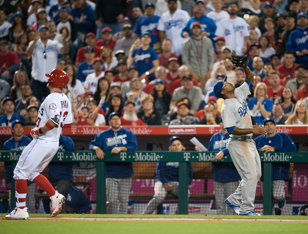 The Dodgers' Howie Kendrick catches a foul ball by the Angels' Brendan Ryan in the fourth inning Wednesday night at Angel Stadium.<br /> <br /> ///ADDITIONAL INFO:   <br /> <br /> angels.0519.kjs  ---  Photo by KEVIN SULLIVAN / Orange County Register  -- 5/18/16<br /> <br /> The Los Angeles Angels take on the Los Angeles Dodgers in inter-league play at Angel Stadium Wednesday night.