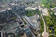 Nederland, Limburg, Gemeente Maastricht, 27-05-2013; Het Noordwest deel van Maastricht. Eiffelgebouw van de voormalige Koninklijke Sphinx (witte gebouw beneden midden) gebouwd in de jaren 30 in de wijk Belvedere. In oktober 2013 is begonnen met de restauratie van het voormalige fabrieksgebouw aan de Boschstraat. Het gebouw vormt al jaren een landmark voor Maastricht. Rechts ervan loopt de Frontensingel (komend van de Noorderbrug), linksboven is het historische centrum met de Markt en het Vrijthof.<br /> North west part of Maastricht, view on the old town (top left). Eiffel Building of the former Royal Sphinx factory (middel bottom) built in the 30s in the Belvedere area of Maastricht. The low-rise building is a well known landmark in Maastricht.<br /> luchtfoto (toeslag op standaardtarieven);<br /> aerial photo (additional fee required);<br /> copyright foto/photo Siebe Swart.
