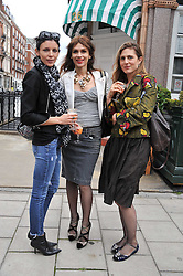 Left to right, LIBERTY ROSS, LARA BOHINC and COSIMA SPENDER at a lunch to celebrate the the Lulu & Co Autumn/Winter 2011 collection held at Harry's Bar, 26 South Audley Street, London W1 on 21st June 2011.