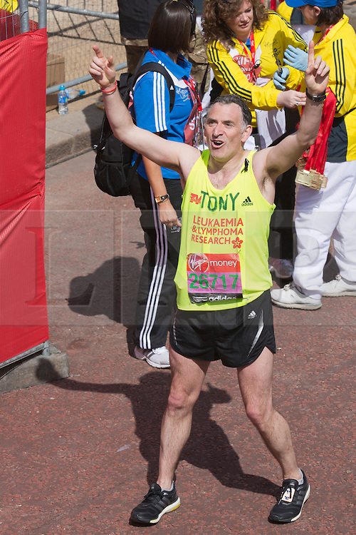 © Licensed to London News Pictures. 21/04/2013. London, England. Picture: Actor Tony Audenshaw. Celebrity Runners and Fun Runners finish the Virgin London Marathon 2013 race in the Mall, London. Many wore black ribbons to pay their respect for those who died or were injured in the Boston Marathon. Photo credit: Bettina Strenske/LNP