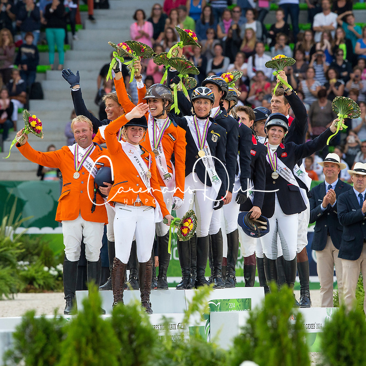 Podium team test eventing 1. GER, 2. GBR, 3. NED - Alltech FEI World Equestrian Games™ 2014 - Normandy, France.<br /> © Hippo Foto Team - Leanjo De Koster<br /> 31-08-14
