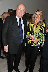 LORD FELLOWES and HELEN ROBINSON at a party to celebrate the publication of Fame Game by Louise Fennell held at Grace, West Halkin Street, London on 12th March 2013.