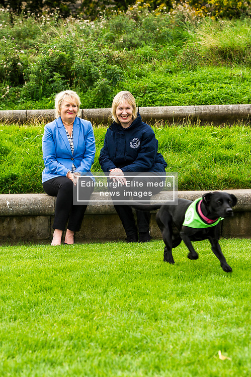 Pictured: Roseanna Cunningham, Holly (black labrador aged four) and Dee McIntosh, Comminucations Director for Battersea Dogs and Cat Home<br /> Cabinet secretary for Environment, Climate Change and Land Reform, Roseanna Cunningham, MSP, joined Dee McIntosh, Comminucations Director for Battersea Dogs and Cat Home and representatives from animal welfare charities outside the Scottish Parliament as they backed a campaign calling for an increase to the maximum prison sentence for animal cruelty from 12 months to five years. <br /> <br /> <br /> Ger Harley   EEm 20 September 2017