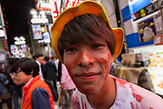 A Japanese man dressed as a bloodied elementary school student during the Halloween celebrations Shibuya, Tokyo, Japan. Saturday October 27th 2018. The celebrations marking this event have grown in popularity in Japan recently. Enjoyed mostly by young adults who like to dress up, drink , dance and misbehave in parts of Tokyo like Shibuya and Roppongi. There has been a push back from Japanese society and the police to try to limit the bad behaviour.