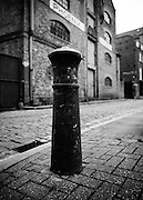 Located opposite Phoenix Wharf in Wapping High Street, this c1850′s bollard is made from a Napoleonic cannon, with a cannon ball on the top. Bollards were used to keep horses and carts on the road and prevent people on the narrow pavement being killed by them as they turned corners.