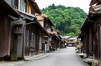 Omori Iwami Ginzan Townscape - The townscape of Omori flourished as the base of the Iwami Ginzan Silver Mine. Red roof tiles are known as a famous local specialty of the town.  Omori has samurai homes from the Edo Period, most notably that of Kumagai family, wealthy merchants of the time. Kumagai House is richly decorated with ornate decor and furnishings, a reminder of its past riches. Other historical buildings retain the architectural style and atmosphere of the time, shops and cafes in a renovated Japanese style houses.