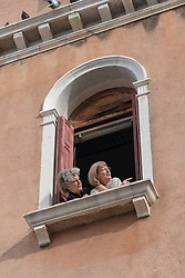 Two women at a window in Venice. From a series of travel photos in Italy. Photo date: Monday, February 11, 2019. Photo credit should read: Richard Gray/EMPICS Entertainment