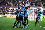 Christian Eriksen of Tottenham (c )celebrates  with his teammates after he scores his teams 2nd goal to equalise at 2-2.Barclays premier league match, Swansea city v Tottenham Hotspur at the Liberty Stadium in Swansea, South Wales on Sunday 4th October 2015.<br /> pic by  Andrew Orchard, Andrew Orchard sports photography.