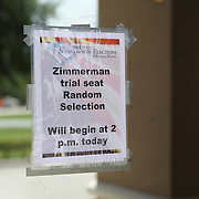 Twenty four seats are available to the general public on a daily basis to sit in the courtroom and witness George Zimmerman's trial in the shooting death of Trayvon Martin at the Seminole County Criminal Justice Center. A lottery system is in place for members of the public to sign their names and deposit them into a box, at the Seminole County Supervisor of Elections office. The seats are drawn randomly, every day before trial proceeds. There were 41 names placed to be drawn for opening day. Image taken Monday, June 24, 2013 in Sanford, Florida. (AP Photo/Alex Menendez)