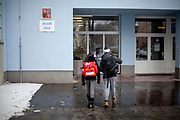 """Antonin Gabor (9, right) and Rachel Klemparova (9) in front of their school building. Antonin visits the 3rd class, Rachel the 4th. Both are visiting the """"Nadrazni"""" school in Ostrava where Roma and non Roma children are educated together."""