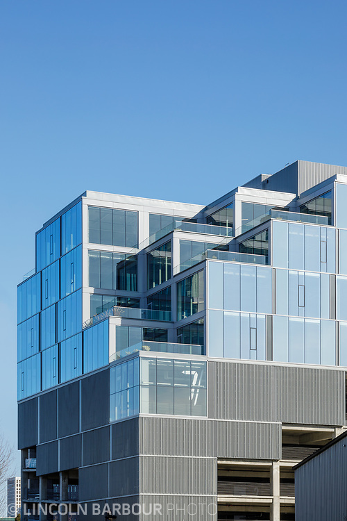 A vertical view of the top half of the 7 Stark Building in Portland, Oregon showing how the building looks like giant stairs or stacked blocks.