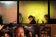 Night commuters seen through the fogged up glass of a bus in Shanghai, China on 20 April 2010. At 600 meters in Hight, the tower, also known as Canton Tower, is the world's tallest TV towers.