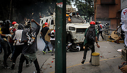 A Venezuelan National Guard riot control vehicle runs over an opposition demonstrator during a protest against Venezuelan President Nicolas Maduro, in Caracas on May 3, 2017