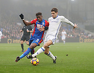 Crystal Palace's Wilfred Zaha tussles with Chelsea's Marcos Alonso during the Premier League match at Selhurst Park Stadium, London. Picture date December 17th, 2016 Pic David Klein/Sportimage