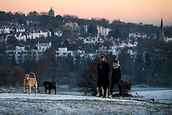 © Licensed to London News Pictures. 29/12/2016. London, UK. Dog walkers on Parliament Hill on Hampstead Heath London at sunrise on another cold winter morning. Most of the UK has woken to freezing temperatures. Photo credit: Ben Cawthra/LNP