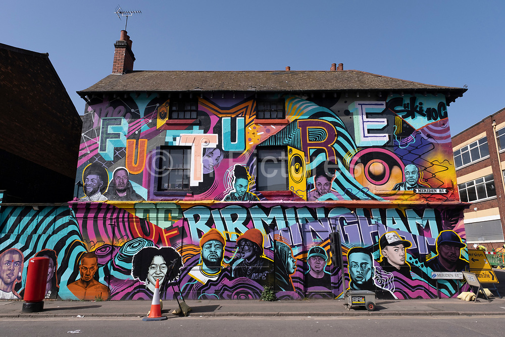 The future of Birmingham street art mural showing a multicultural vision of the city in Digbeth on 31st March 2021 in Birmingham, United Kingdom. The mural depicts black and mixed ethnic people and relevant cultural references.