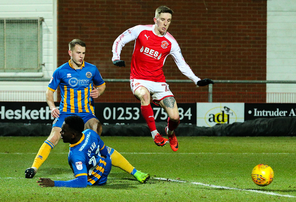 Fleetwood Town's Ashley Hunter is tackled by Shrewsbury Town's Aristote Nsiala<br /> <br /> Photographer Alex Dodd/CameraSport<br /> <br /> The EFL Sky Bet League One - Fleetwood Town v Shrewsbury Town - Tuesday 13th February 2018 - Highbury Stadium - Fleetwood<br /> <br /> World Copyright © 2018 CameraSport. All rights reserved. 43 Linden Ave. Countesthorpe. Leicester. England. LE8 5PG - Tel: +44 (0) 116 277 4147 - admin@camerasport.com - www.camerasport.com