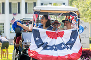 Mount Pleasant, United States of America. 04 July, 2020. A traditional golf cart and bicycle Independence Day parade is held despite a dramatic rise in COVID-19, coronavirus cases in Charleston County July 4, 2020 in Mount Pleasant, South Carolina. South Carolina is currently number three nationwide in number of infected per population.  Credit: Richard Ellis/Alamy Live News