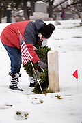 19 DECEMBER 2020 - DES MOINES, IOWA: Volunteers working with Wreaths Across America placed Christmas wreaths on the headstones of more than 600 US military veterans in Woodland Cemetery in Des Moines. The cemetery, one of the first in Des Moines, has the graves of veterans going back to the War of 1812.        PHOTO BY JACK KURTZ