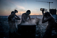 Migrant washing outside in a makeshift camp in Belgrade, Serbia. 15th January 2017. Federico Scoppa