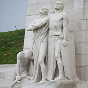 The pacifist Breaking of the Swords statue  of the Canadian National Vimy Memorial dedicated to the memory of Canadian Expeditionary Force members killed in World War one. The monument is situated at a 100 hectare preserved battlefield with wartime tunnels, trenches, craters and unexploded munitions. The memorial designed by Walter Seymour Allward opened in 1936.