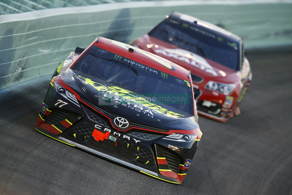 November 19, 2017 - Homestead, Florida, United States of America - November 19, 2017 - Homestead, Florida, USA: Erik Jones (77) brings his car through the turns during the Ford EcoBoost 400 at Homestead-Miami Speedway in Homestead, Florida. (Credit Image: © Chris Owens Asp Inc/ASP via ZUMA Wire)