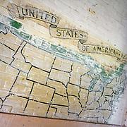 WW2 wall map painting showing American states at the former Flixton air force base in Suffolk, England. Flixton was the home of the 706th Bombardment Squadron, an operational squadron of the USAAF's 446th Bombardment Group (Heavy). The 446th operated chiefly against strategic objectives on the Continent from December 1943 until April 1945. Targets included U-boat installations at Kiel, the port at Bremen, a chemical plant at Ludwigshafen, ball-bearing works at Berlin, aero-engine plants at Rostock, aircraft factories at Munich, marshalling yards at Coblenz, motor works at Ulm, and oil refineries at Hamburg. After the war, the buildings reverted to agricultural and industrial use.