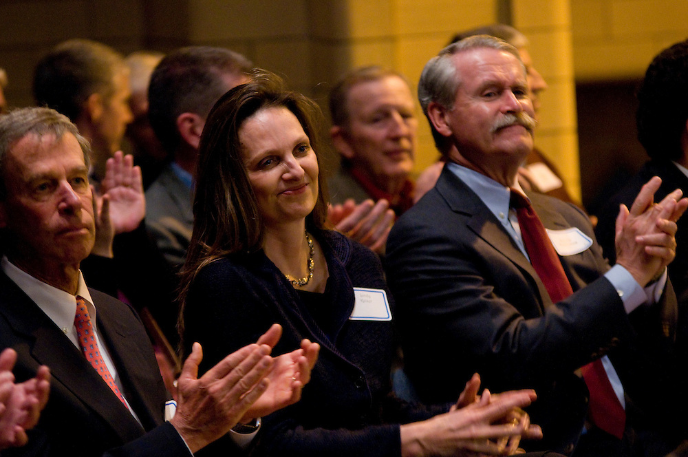 Michael and Lindy Keiser (L to R) and Dennis Fitzsimmons applaud a performance by students at St. Angela's Catholic School during Lend a Shoulder Day. The annual event introduces civic and corporate leaders to Chicago's catholic schools that benefit from the Big Shoulders Fund. The Fund has raised 193 million dollars since 1986 that are granted to 93 Catholic schools for tuition and operating costs.