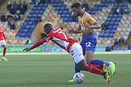 Mark Marshall of Charlton Athletic (7) is fouled by CJ Hamilton of Mansfield Town (22) during the The FA Cup match between Mansfield Town and Charlton Athletic at the One Call Stadium, Mansfield, England on 11 November 2018.