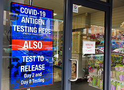 © Licensed to London News Pictures. 09/08/2021. London, UK. Covid-19 antigen testing advert displayed on a pharmacy's window in north London. Health Secretary Sajid Javid has asked the UK's competition watchdog to investigate PCR Covid test firms that are selling tests at excessive prices and engaging in exploitative practices following complains from holidaymakers of high prices and poor service from many of the 400-plus firms offering PCR tests. Photo credit: Dinendra Haria/LNP