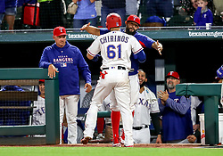 April 23, 2018 - Arlington, TX, U.S. - ARLINGTON, TX - APRIL 23: Texas Rangers catcher Robinson Chirinos gets a hug from Rougned Odor after hitting a home run during the game between the Texas Rangers and the Oakland Athletics on April 23, 2018 at Globe Life Park in Arlington, Texas. (Photo by Steve Nurenberg/Icon Sportswire) (Credit Image: © Steve Nurenberg/Icon SMI via ZUMA Press)