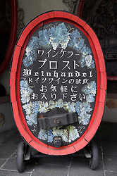 Japanese writing for tourists on wine barrel in popular town of Rudesheim on River Rhine in Germany