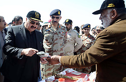 October 20, 2016 - Pakistan - QUETTA, PAKISTAN, OCT 20: Balochistan Chief Minister, Sanaullah Zehri being briefed .about confiscated drugs during the incineration ceremony of seized illegal drugs, held at Kuch .Mor located on Quetta Cantonment area on Thursday, October 20, 2016. The law enforcement .agency burnt a large quantity of narcotics and alcohol seized in different parts of the province. (Credit Image: © PPI via ZUMA Wire)