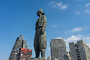 A statue representing the Lebanese expatriate is seen in front of residential buildings at the Port of Beirut on Saturday, Aug 22, 2020 - nearly 3 weeks after the explosion that devastated the city. (VXP Photo/ Matt Kynaston)