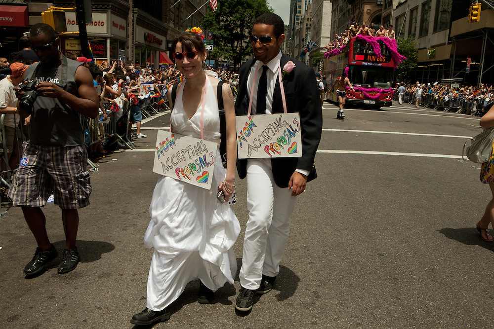 Two people now accepting proposals in the 2011 Pride Parade on New York's Fifth Avenue. New York legalized gay marriage less than two days before the start of the parade.