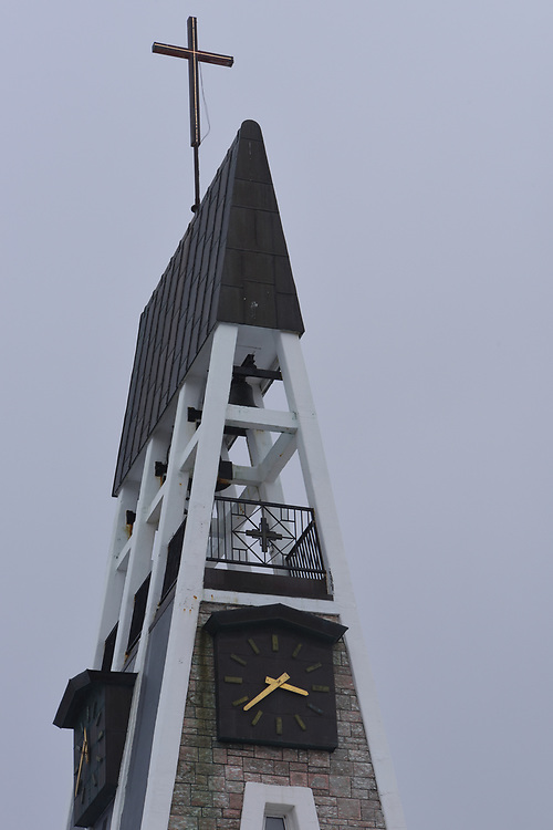 The top of the spire and bell tower of Hammerfest parish church. Hammerfest, Finnmark, Norway.