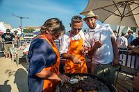 Saintes-Maries de la mer, Juin 2014: Championnat de France de BBQ.<br /> A l'approche de l'ete, sacro sainte saison du barbecue en tout genre, la ville des Saintes-Maries de la mer organise le 3eme championat de France de barbecue sous le regard de nombreuses tele etrangeres.<br /> Les participants viennent de toutes regions, y compris la Guadeloupe, la Reunion ou encore les Marquises.<br /> Cette annee 2 guest stars americaines sont venues des USA<br /> Depuis un grand nombre d'annees de nombreux pays organisent ces festivités se terminant par un championnat du monde. L'Argentine fut longtemps un vainqueur inconteste.
