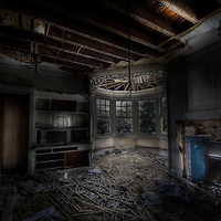 An abandoned house in London UK.Image showing fallen lathe, fireplace and window detail.