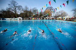 ©  London News Pictures. 26/01/2013. London, UK. Competitors race in the Cold Water Swimming Championships at Tooting Bec Lido in South London on January 26, 2013. The biannual event sees some competitors dress in costume. Photo credit: Ben Cawthra/LNP