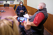 "14 OCTOBER 2020 - KNOXVILLE, IOWA: THERESA GREENFIELD, the Democratic candidate for US Senator from Iowa, (left) talks to MAX SMITH in the office at Smith Fertilizer and Grain. Greenfield toured Smith Fertilizer and Grain in Knoxville and talked to owner Max Smith about her ""Fair Shot for Our Farmers"" plan to improve Iowa's farm economy. Greenfield is in a tight race with incumbent Republican Senator Joni Ernst.     PHOTO BY JACK KURTZ"