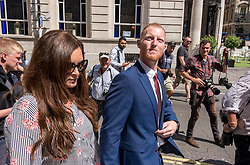 © Licensed to London News Pictures. 06/08/2018. Bristol, UK.  England cricketer BEN STOKES (blue suit) outside Bristol Crown court at lunchtime on the first day of his trial on charges of affray that relate to a fight outside a Bristol nightclub on September 25 2017. Stokes and two other men, Ryan Ali, 28, and Ryan Hale, 27, all deny the charge. Stokes, Ali and Hale are jointly charged with affray in the Clifton Triangle area of Bristol on September 25 last year, several hours after England had played a one-day international against the West Indies in the city. A 27-year-old man allegedly suffered a fractured eye socket in the incident. Photo credit: Simon Chapman/LNP