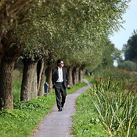 Nederland, Delft , 29 september 2010..Schrijver Kader Abdolah tijdens een wandeling door het centrum van Delft en de Bieslandse Bossen. ..Writer and Koran translator Kader Abdolah during a stroll througha typical Dutch landscape near Delft, the Netherlands.